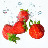 Fresh summer strawberries. Dropped into water Stock Photo