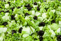 Fresh summer vegetable salad with cucumbers and olives Stock Image