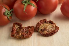 Fresh and dried tomatoes Royalty Free Stock Image