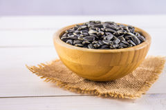 Fresh Sunflower seed. Shelled sunflower seeds in wood bowl. Stock Photos