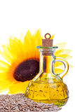 Fresh sunflower seeds oil in a bottle isolated on white Royalty Free Stock Photography