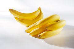 Fresh sunny bananas on a white background Stock Images