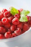Fresh sunny raspberries closeup. On a plate Stock Photography