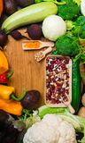 Fresh super food concept with vegetables and beans Foods high in fibre, anthocyanins, antioxidants, smart carbohydrates, minerals. And vitamins in wooden board royalty free stock image
