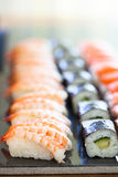 Fresh sushi. Closeup of rows of healthy freshly prepared sushi stock images