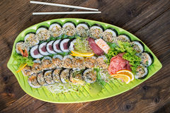 Fresh sushi on green platter Stock Image