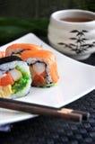 Fresh sushi with hot tea Stock Image