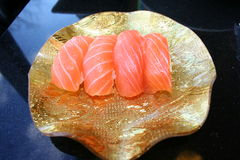 Fresh Sushi Rolls. A gold plate of four rolls of fresh sushi Stock Image