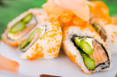 Fresh sushi rolls with asparagus and caviar on a Royalty Free Stock Photo
