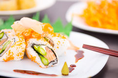 Fresh sushi rolls with asparagus and caviar on a Stock Photography