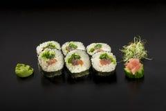 Fresh sushi rolls hosomaki decorated with seaweed salad. And wasabi Royalty Free Stock Photo