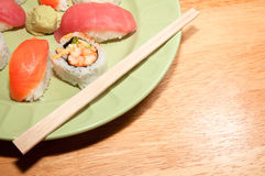 Fresh Sushi Rolls and Sashimi Over Rice Stock Photos