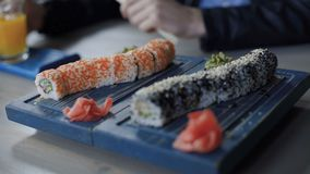 Fresh sushi rolls on table 4K.  stock footage