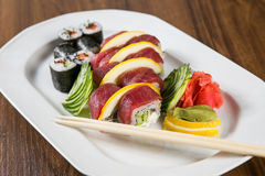 Fresh Sushi rolls. On a white plate Royalty Free Stock Photography