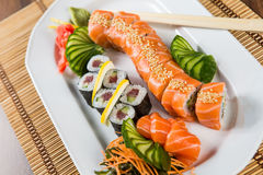 Fresh Sushi rolls. On a white plate Royalty Free Stock Images