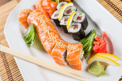Fresh Sushi rolls. On a white plate Royalty Free Stock Photos