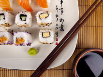 Fresh sushi and sashimi on a plate with chopsticks Stock Photography