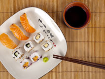 Fresh sushi and sashimi on a plate with chopsticks Stock Photo