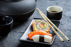 Fresh sushi served in a black ceramic Royalty Free Stock Photography