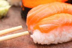 Fresh sushi traditional japanese food. Close up fresh sushi traditional japanese food with chopsticks royalty free stock photography