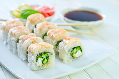 Fresh sushi. On the white plate Royalty Free Stock Photography