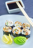Fresh sushi. On the white plate Stock Photography