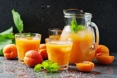 Fresh sweet apricot juice and mint. Selective focus Stock Images