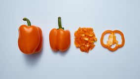Fresh sweet bell peppers slices and half isolated on gray bacgkround Royalty Free Stock Photo