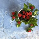 Fresh, sweet berries on stone background. royalty free stock images