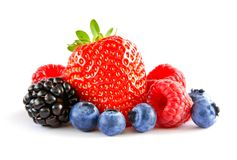 Fresh Sweet Berries on the White Background. Ripe Juicy Strawberry, Raspberry, Blueberry, Blackberry royalty free stock photography