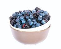 Fresh sweet blueberries and blackberries. On white background Royalty Free Stock Photo