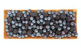 Fresh sweet blueberries and blackberries. On white background Royalty Free Stock Photos
