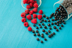 Fresh sweet blueberry, raspberry . Heart shape of fresh raspberries and blueberries. Dessert healthy food. Raw summer. Heart shape of fresh raspberries and Stock Photography