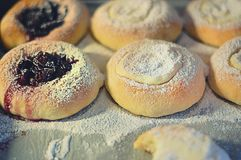 Fresh sweet buns with jam and cottage cheese. Fresh sweet buns with jam and curd, just out of oven, for kids Stock Photo