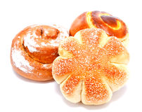 Fresh sweet buns and rolls with cream and cinnamon isolated Royalty Free Stock Photo