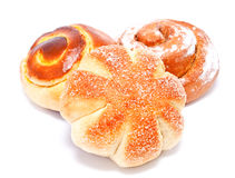 Fresh sweet buns and rolls with cream and cinnamon isolated Stock Images
