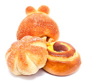 Fresh sweet buns and rolls with cream and raisin isolated Stock Image