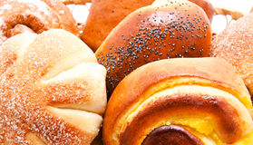 Fresh sweet buns and rolls with poppy and cream Stock Image