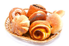 Fresh sweet buns and rolls with poppy and cream in the basket Stock Image