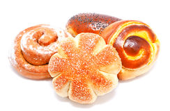 Fresh sweet buns and rolls with poppy and cream isolated Stock Images