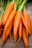 Fresh and sweet carrot on a grey wooden table Royalty Free Stock Photo