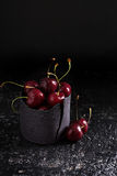 Fresh sweet cherries in black cup Stock Images
