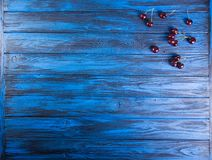 Fresh sweet cherries fruits on blue wooden background. Overhead. stock photography