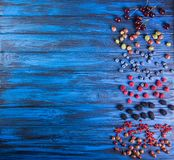 Fresh sweet cherries fruits on blue wooden background. Overhead. stock photos