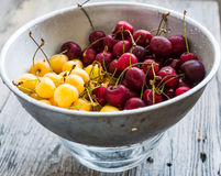 Fresh sweet cherries red and yellow in a metal colander Royalty Free Stock Photos