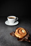 Fresh Sweet Cinnamon Roll and coffee Stock Images