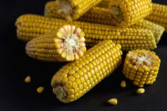 Fresh sweet corn on cobs. At black rustic table. Close up Royalty Free Stock Images