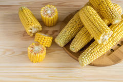 Fresh sweet corn on cobs. At rustic wooden table Stock Image