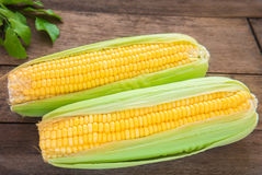 Fresh sweet corn on wooden table Royalty Free Stock Images