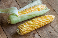 Fresh sweet corn on wooden table. Selective focus Stock Image